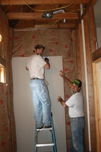 Showing Buckley the ropes in the sheetrock hanging business...