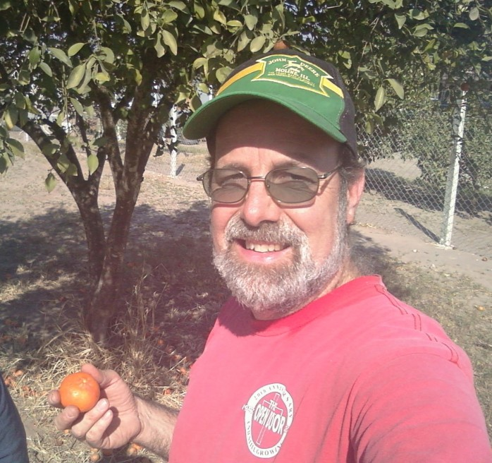 As if there isn't enough food being brought to us, there are TWO TANGERINE TREES on the job site! Oh, the madness! (And no, you can't have that sporty hat)