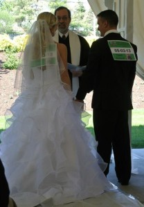 """Angela looked a little shocked when I whipped out these numbers, but they both played along and even kept their """"bibs"""" on throughout the ceremony."""