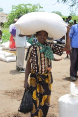 I took this photo of an heroic woman and her daughter (see that little foot!) carrying 100 pounds of food home during the famine relief effort in Malawi in 2013.
