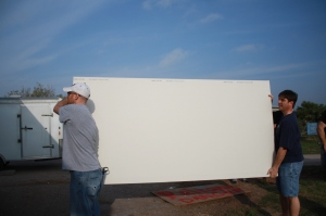 Joe and Chris unloading sheetrock - we carried in 60 today, and hung about 40.