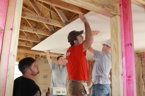 Mike, Joe, and Steve spent most of the day hanging the ceiling.  Here, I'm trying not to get in their way.