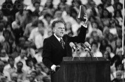 Billy Graham Preaching, Bible Raised