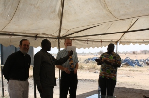 Ken White presents a gift from the Presbytery to assist the SSPEC in their care for Internally Displaced Persons.