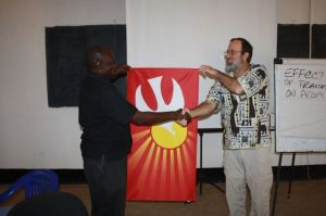 Presenting a gift - the banner of peace and the Holy Spirit - to the Rev. Peter Tibi, Executive Director at Reconcile