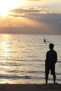 Gabe enjoys a sunrise over Lake Malawi.