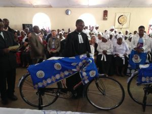 Pastors are typically given bicycles like this as they begin their ministry.  One fortunate fellow today was given a motorcycle with which to move through his parish.
