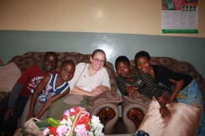 Sharon posing with the Munyenye children, whom she taught to play UNO this evening.