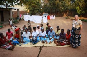 Sharon with the women of the Mpasuka Bible Study, from whom she received the gift of a chitenge fabric.