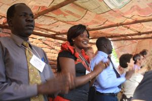 Members of the SSPEC (South Sudan) delegation are leading the celebration.