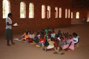 "The Sunday School program for the children meets in the unfinished ""new building"" of the Mbenjere Church."