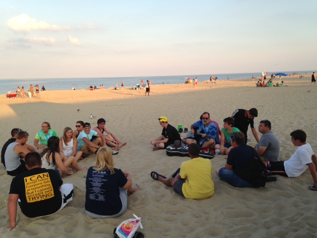 Devotions on the beach at sunset.