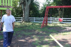 Evan strolls through the playground as we prepare to lay down the mulch.