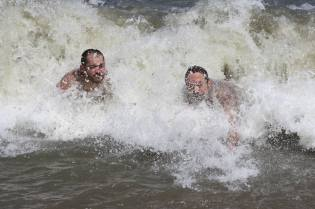 A couple of veterans show 'em how a wave ought to be ridden.