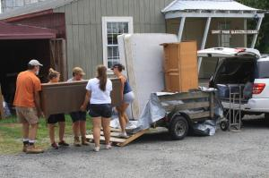 Loading all of S's possessions into our little trailer to help her move her little family to their new home.