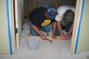 Bob and Nemorio working to frame the shower stall.