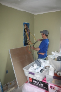 Gabe working to sort out the electrical system.