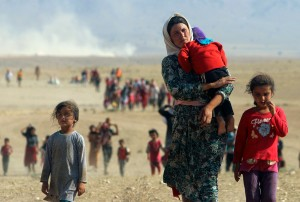 A Yazidi woman and her family , Iraq, 2014 (Reuters)