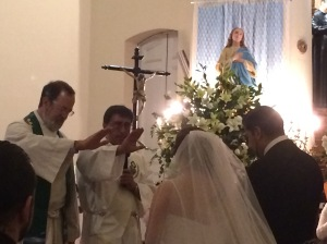 The Deacon invited me to share in the blessing of the couple.