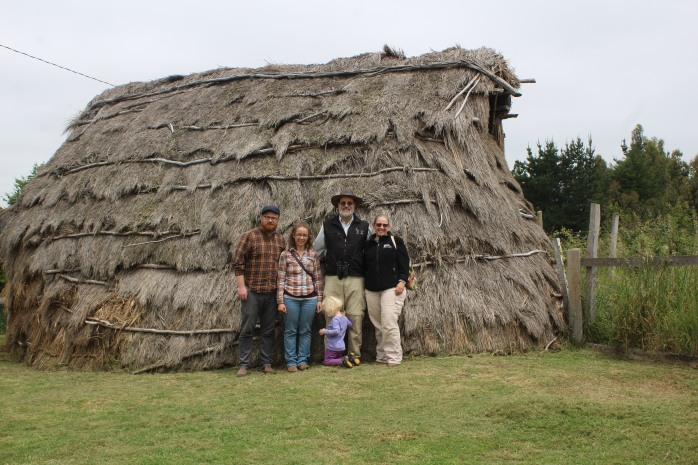 "Outside a ""Ruka"", the traditional home and gathering place of the Mapuche."