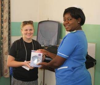 Handing over supplies to the Supervisor of Nursing at MMH