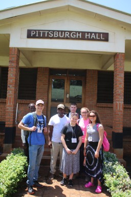 "With Keith Lipato outside ""Pittsburgh Hall"" at Mulanje School of Nursing."