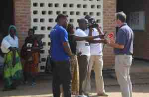One of the benefits of a trip like this is to be able to call attention to challenges and possible responses. Here I am talking with the Malawian Broadcasting System television and radio teams at the food distribution center.