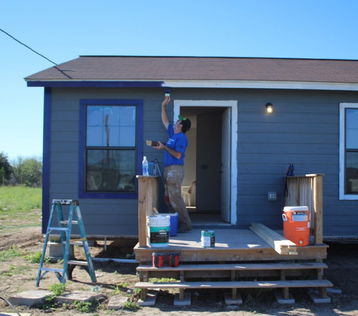 Dave applying the trim - a deep purple to accent the slate gray/blue siding.